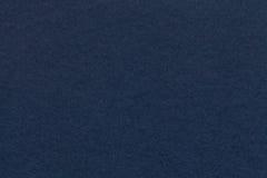 Textura del primer viejo del papel de azules marinos Estructura de una cartulina densa El fondo del dril de algodón Foto de archivo