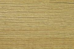 Textura del tablero agrietado seco un fondo beige ligero Foto de archivo libre de regalías