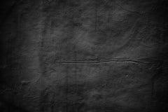 Textura desagradável da parede, cimento escuro do preto do fundo imagens de stock royalty free