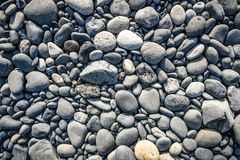 Textura with different sized stones lying on the beach in Iceland royalty free stock photo