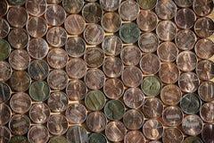 Textura do arranjado em um número de moedas de um centavo americanas Fotos de Stock