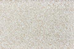 Textura do arroz Fundo lustrado da aveia em flocos do arroz imagem de stock royalty free