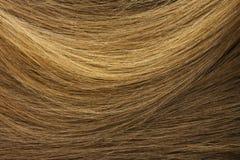 Textura do cabelo louro da mulher Fotografia de Stock