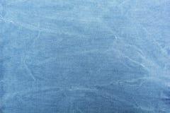 Textura do close-up azul da tela da sarja de Nimes, espaço para o texto fotos de stock royalty free