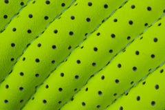 Textura do couro verde com furos Fotos de Stock Royalty Free