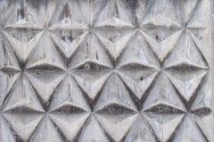 Textura do fundo da cerca concreta cinzenta com teste padrão triangular Imagem de Stock