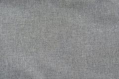 Textura do fundo da tela feita malha cinza Imagem de Stock