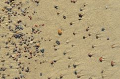 Textura do fundo de pedras da areia do mar Imagem de Stock