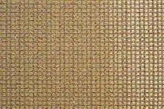 A textura do fundo de uma matéria têxtil sintética sob a forma de uma estrutura quadrada foto de stock royalty free