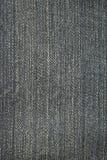 Textura do fundo preto das calças de brim Foto de Stock