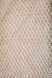 Textura do fundo teste padrão bege da tela feita malha feita da opinião superior do algodão ou das lãs imagem de stock royalty free