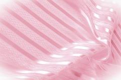 Textura do fundo, teste padrão Tela de seda cor-de-rosa com uma tira clara foto de stock