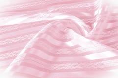 Textura do fundo, teste padrão Tela de seda cor-de-rosa com uma tira clara fotografia de stock