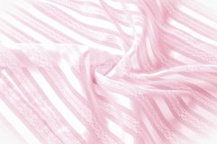Textura do fundo, teste padrão Tela de seda cor-de-rosa com uma tira clara imagem de stock royalty free