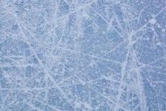 Textura do gelo da pista da patinagem no gelo Fotos de Stock Royalty Free