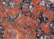 Textura do granito Base castanho-avermelhado com os pontos pretos e cinzentos usado como um fundo fotos de stock royalty free