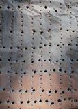 Textura do metal da oxidação com furos Fotografia de Stock