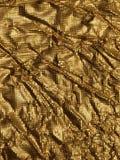 Textura do metal do fundo do ouro Foto de Stock