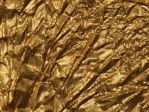 Textura do metal do fundo do ouro Fotografia de Stock Royalty Free