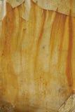 Textura do metal oxidado velho e da pintura amarela Imagem de Stock