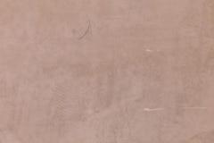 Textura do muro de cimento de Brown com algum garrancho imagem de stock royalty free