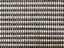 A textura do rattan de Brown tece por preto e por claro - fundo marrom da linha foto de stock