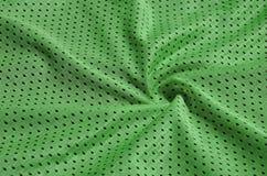 Textura do sportswear feita da fibra de poliéster O vestuário para a formação dos esportes tem uma textura da malha do fabri de n foto de stock