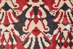 A textura do tapete Tapete velho vermelho imagens de stock