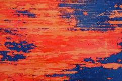 Textura do vermelho, a azul e laranja afligida do metal do fundo Imagem de Stock