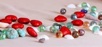 Textura dos corações, das pedras e dos shell fotografia de stock