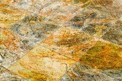 Textura dos rombos feitos de telhas caras bonitas do marrom cerâmico de pedra do granito O fundo fotografia de stock royalty free