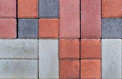 A textura dos tijolos de pavimentação de cores diferentes para a construção Enfrentando o material de constru??o imagem de stock