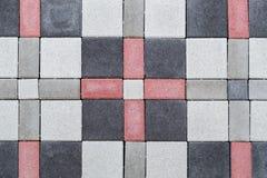 A textura dos tijolos de pavimentação de cores diferentes para a construção Enfrentando o material de constru??o imagens de stock
