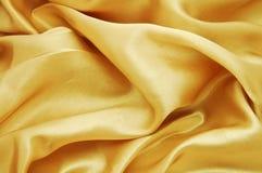 Textura dourada de veludo Fotografia de Stock Royalty Free