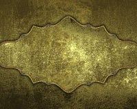 Textura dourada do Grunge com placa de ouro Elemento para o projeto Molde para o projeto copie o espaço para o folheto do anúncio Imagem de Stock