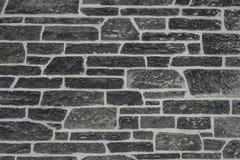 Textura escura antiga da parede de pedra foto de stock