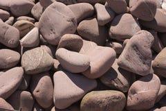 Textura - fondo de piedras Piedra del color Piedra del adoquín Grava ripícola - piedra redonda Fotos de archivo libres de regalías
