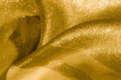 Textura, fondo, modelo Tela - luz de seda El oro es yello Imagenes de archivo