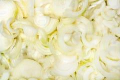 Textura fresca de las cebollas del corte foto de archivo