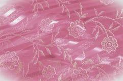 Textura, fundo, teste padrão Laço cor-de-rosa decorado com flores o fotografia de stock