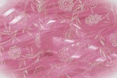 Textura, fundo, teste padrão Laço cor-de-rosa decorado com flores o fotos de stock
