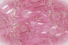 Textura, fundo, teste padrão Laço cor-de-rosa decorado com flores o fotografia de stock royalty free