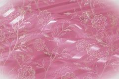 Textura, fundo, teste padrão Laço cor-de-rosa decorado com flores o foto de stock