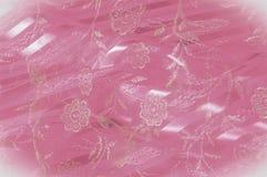 Textura, fundo, teste padrão Laço cor-de-rosa decorado com flores o fotos de stock royalty free