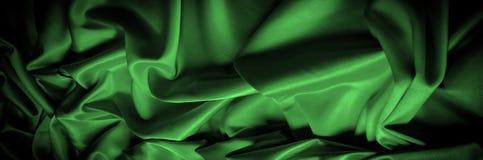 Textura, fundo, teste padrão A seda da tela é escura - verde expresse imagem de stock royalty free