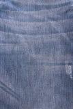 Textura gasto de calças de ganga amarrotada Imagens de Stock