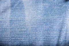 Textura gasto de calças de ganga do fundo Fotografia de Stock Royalty Free