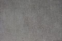 Textura gris concreta de la pared áspera urbana fuera de un edificio fotografía de archivo