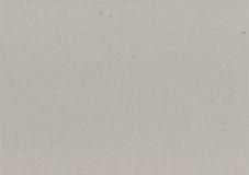 Textura gris de la cartulina del papel de embalaje, fondo texturizado áspero ligero del espacio de la copia, gris, marrón, moreno Fotografía de archivo libre de regalías