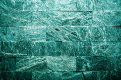 Textura gris decorativa de la pared de piedra para el fondo entonado Foto de archivo